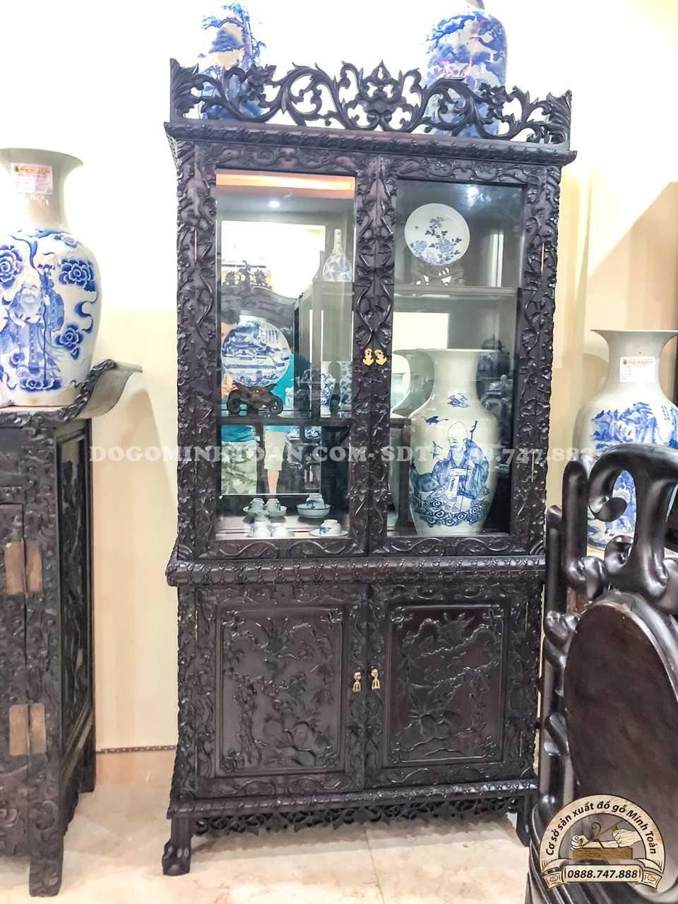 Tủ trưng bày đồ cổ đục mai dắt 2 cánh gỗ gụ
